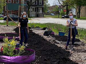 CEM Team members spreading soil